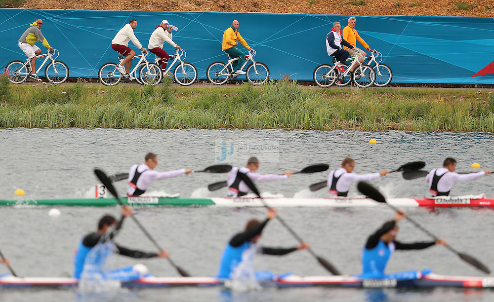 Coaches follow competitors on bicycles during the K4 1000m kayak at Eton Dorney during day 11 of the London Olympic Games in London, England, United Kingdom on August 7, 2012..(Jed Jacobsohn/for The New York Times)..