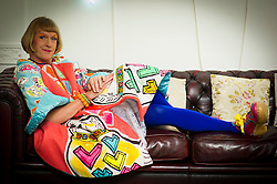 Artist Grayson Perry poses for photographs called 'Bad Portraits of Establishment Figures' I, 2012 valued between £50,000- 70,000, Royal Academy of Arts, London, October 2, 2012. Photo by Ki Price / i-Images.