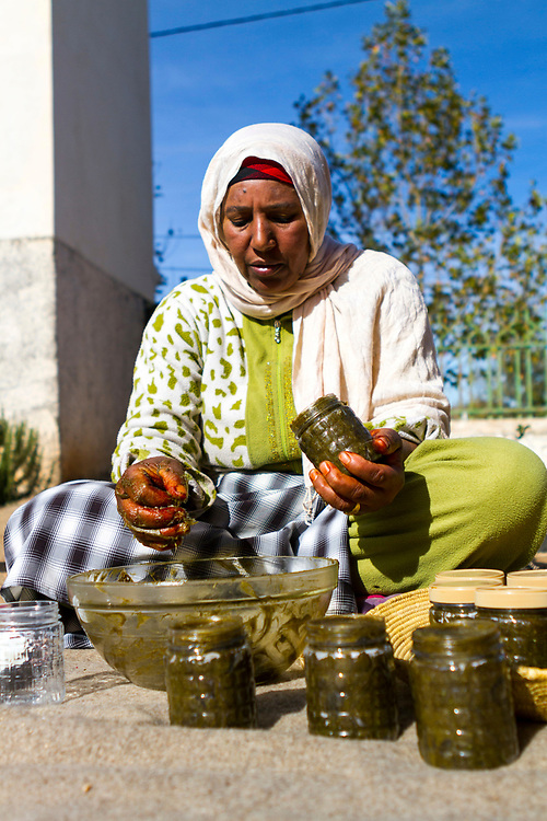 Association member makes black soap used for hammams at the Al Amal Cooperative in Azrou, Middle Atlas region of Morocco