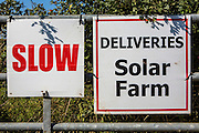 The Solar farm delivery sign outside Braydon Manor Farm site where Solarcentury started building Wiltshire Wildlife Community Energy's (WWCE) 5MWp community-owned solar farm. Over 18,000 solar panels will be installed across 18 acres and the solar system will generate enough energy to power over 1,400 homes and save 2,500 tonnes of carbon a year