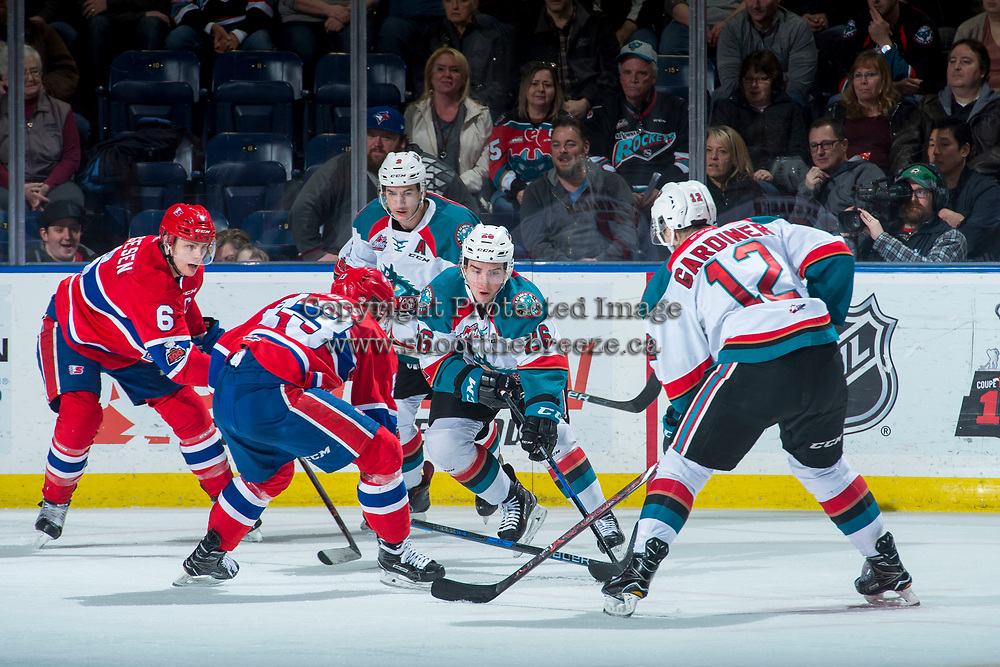 KELOWNA, CANADA - MARCH 3:  Liam Kindree #26 of the Kelowna Rockets digs for the puck against the Spokane Chiefs on March 3, 2018 at Prospera Place in Kelowna, British Columbia, Canada.  (Photo by Marissa Baecker/Shoot the Breeze)  *** Local Caption ***