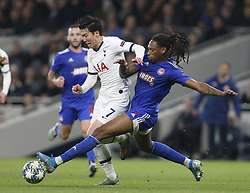 LONDON, Nov. 27, 2019  Tottenham Hotspur's Heung-Min Son (2nd R) is tackled by Olympiakos' Ruben Semedo during the UEFA Champions League Group B match at the Tottenham Hotspur Stadium in London, Britain on Nov. 26, 2019..FOR EDITORIAL USE ONLY. NOT FOR SALE FOR MARKETING OR ADVERTISING CAMPAIGNS. NO USE WITH UNAUTHORIZED AUDIO, VIDEO, DATA, FIXTURE LISTS, CLUB/LEAGUE LOGOS OR ''LIVE'' SERVICES. ONLINE IN-MATCH USE LIMITED TO 45 IMAGES, NO VIDEO EMULATION. NO USE IN BETTING, GAMES OR SINGLE CLUB/LEAGUE/PLAYER PUBLICATIONS. (Photo by Matthew Impey/Xinhua) (Credit Image: © Han Yan/Xinhua via ZUMA Wire)