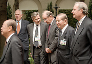 US Federal Reserve Chairman Alan Greenspan (center) talks with Jean-Claude Trichet, governor of the central bank of France during a group photo for the International Monetary Fund-World Bank annual meeting October 6, 1998 in Washington, DC.