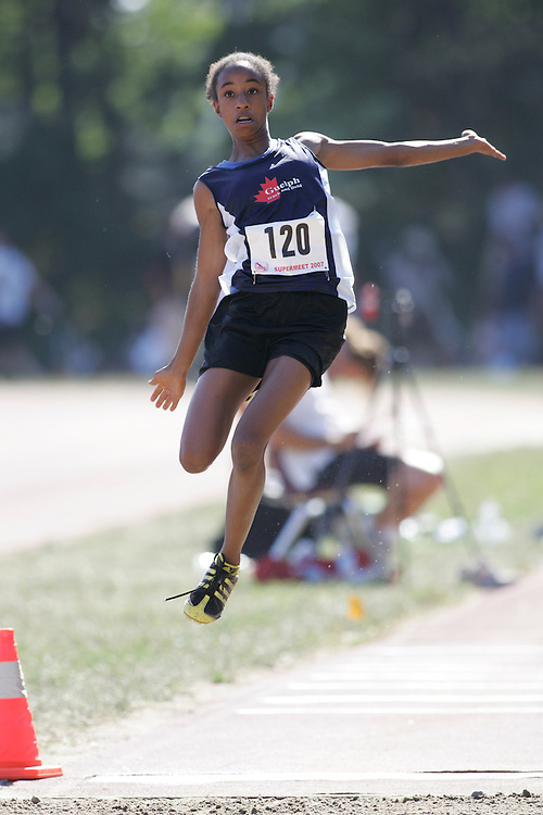Kimberly Cupid competing in the juvenile girls long jump at the 2007 OTFA Supermeet II. The Ontario Track and Field Association Bantam-Midget-Juvenile Championships were held in Toronto from August 3rd to 5th.
