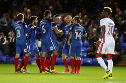 Ryan Tafazolli of Peterborough United is congratulated by team-mates after scoring the opening goal - Mandatory by-line: Joe Dent/JMP - 12/09/2017 - FOOTBALL - ABAX Stadium - Peterborough, England - Peterborough United v Milton Keynes Dons - Sky Bet League One