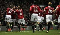 Photo: Paul Thomas.<br /> Manchester United v Wigan Athletic. The Barclays Premiership. 26/12/2006.<br /> <br /> Cristiano Ronaldo celebrates (L) his goal for Man Utd with team-mates.