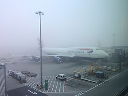 © Licensed to London News Pictures. Heathrow. 3/10/14 . A plane in heavy fog at Heathrow Airport this morning 3rd October 2014. Photo credit : Jon Shave/LNP