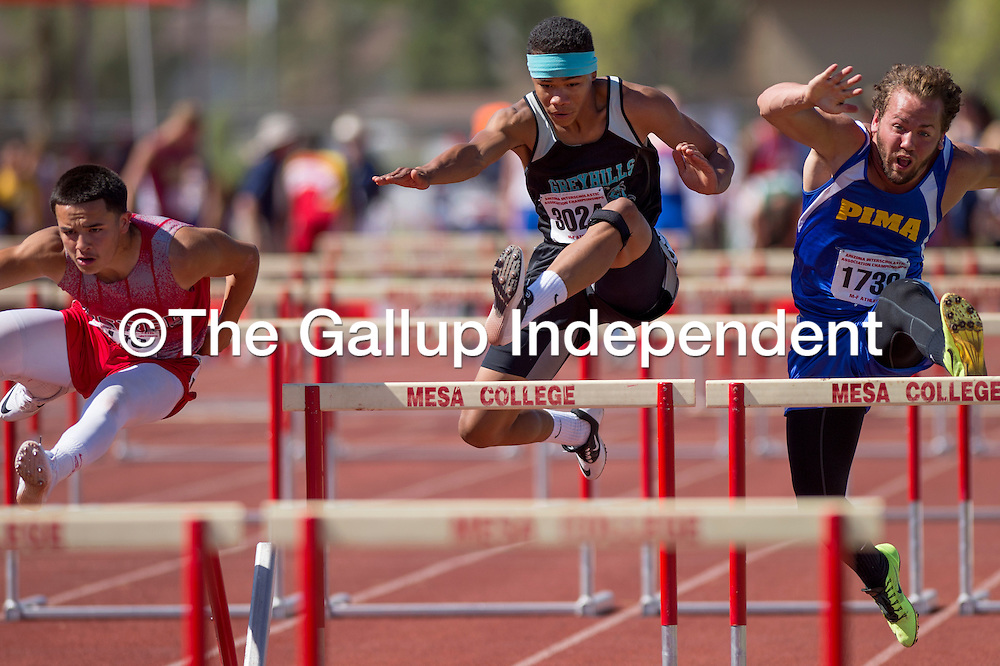 051014       Cable Hoover<br /> <br /> Grey Hills Knight Isaac Williams, center, edges out his competitors in the 110-meter hurdles during the Arizona State Track Meet at Mesa Community College Saturday.