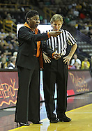 February 24 2011: Illinois Fighting Illini head coach Jolette Law talks with an official during the first half of an NCAA women's college basketball game at Carver-Hawkeye Arena in Iowa City, Iowa on February 24, 2011. Iowa defeated Illinois 83-64.