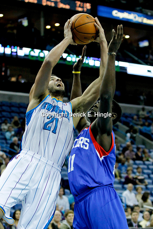 November 7, 2012; New Orleans, LA, USA; New Orleans Hornets point guard Greivis Vasquez (21) shoots over Philadelphia 76ers point guard Jrue Holiday (11) during the first quarter of a game at the New Orleans Arena. Mandatory Credit: Derick E. Hingle-US PRESSWIRE