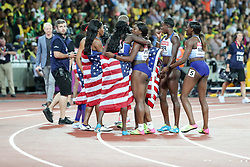 London, August 12 2017 . Team USA  and Team BG celebrate their victory in the women's 4x100m relay on day nine of the IAAF London 2017 world Championships at the London Stadium. © Paul Davey.