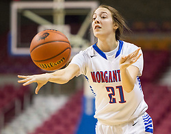 Morgantown forward Brie Giuliani (21) passes the ball to the corner against Buckhannon Upshur during a first round game at the Charleston Civic Center.