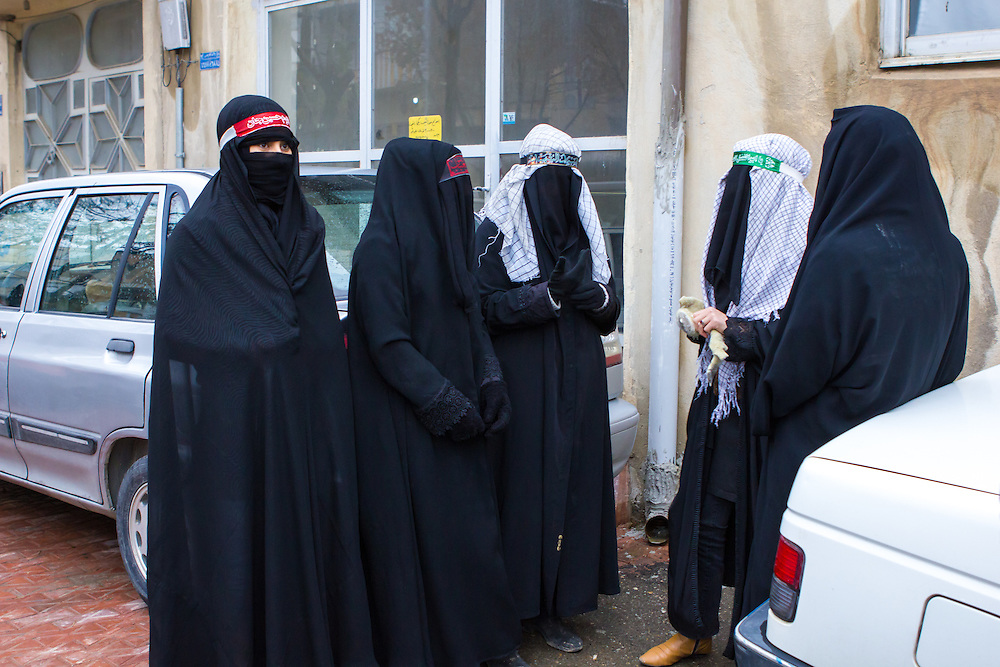 Veiled muslim women, wearing traditional black chadors, mourning during the Day of Ashura, the most important event of the year for shi'a muslims. Bijar, Kurdistan Province, Iran.