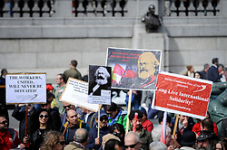 © Licensed to London News Pictures. 01/05/2018. LONDON, UK.  Demonstrators hold up Karl Marx placards during the annual May Day Rally on International Workers' Day, having marched through central London to a rally in Trafalgar Square.  Photo credit: Stephen Chung/LNP