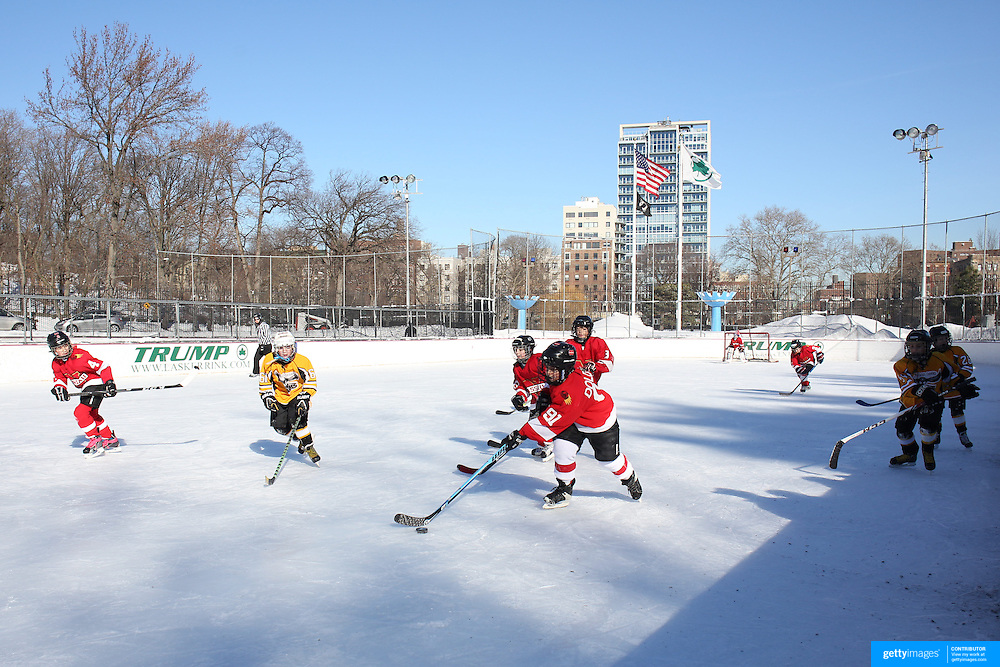 Junior Ice Hockey at Lasker Rink in Central Park after New York City was hit with over 7 inches of snow during its first winter storm of the year. Central Park, Manhattan, New York, USA. 4th January 2014 Photo Tim Clayton