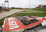 The football scoreboard lays crumpled on the ground next to the football field and Aplington-Parkersburg High School in Parkersburg, Iowa on Wednesday June 4, 2008. (Stephen Mally / Special to The Denver Post)
