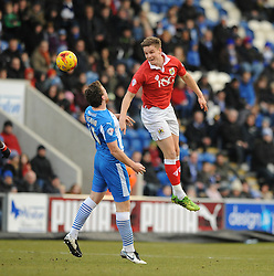 Bristol City's Matt Smith challenges for the header with Colchester United's Tom Eastman - Photo mandatory by-line: Dougie Allward/JMP - Mobile: 07966 386802 - 21/02/2015 - SPORT - Football - Colchester - Colchester Community Stadium - Colchester United v Bristol City - Sky Bet League One