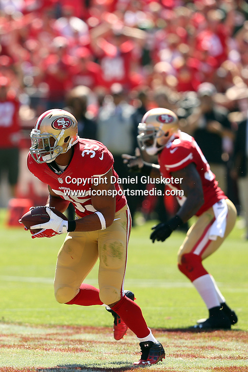 08 September 2013: Niners safety Eric Reid returns an interception during action in an NFL game against the Green Bay Packers at Candlestick Park in San Francisco, CA. The 49ers won 34-28.