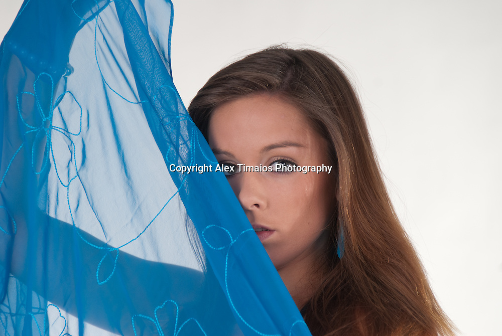 Attractive young woman with blue shawl