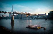 Millennium Bridge and The River Thames with Pedestrians, London, Britain.