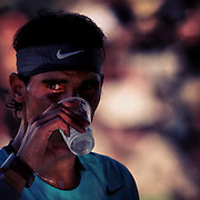 March 4, 2014, Indian Wells, California: <br /> Rafael Nadal takes a drink during a workout on the practice courts at the Indian Wells Tennis Garden. <br /> (Photo by Billie Weiss/BNP Paribas Open)
