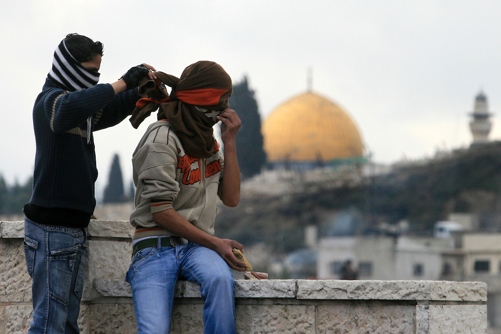 Masked Palestinian youth prepare to clash with the Israeli border police near the Al-Aqsa Mosque compound in East Jerusalem, 16 February 2007. Only Muslim men aged over 50 and in possession of Israeli identity cards were granted entrance to the main weekly Friday prayers, compared to those over 45 last week, although there remained no restrictions on women's access. Photo by Olivier Fitoussi /FLASH90