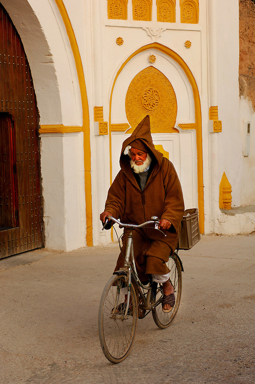 Man riding bicycle, Sidi Wassay, Morocco