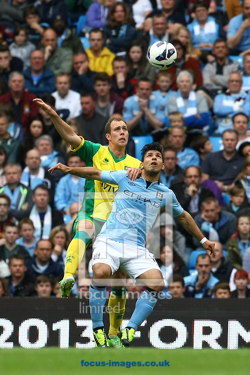 Picture by Paul Chesterton/Focus Images Ltd +44 7904 640267.Steven Whittaker of Norwich and Sergio Agüero of Man City in action during the Barclays Premier League match at The Etihad Stadium, Manchester.