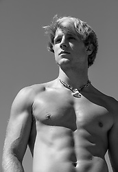 Shirtless blond man