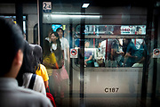Hong Kong, China - Crowds inside The Mass Transit Railway (MTR)  during morning rush hour on 04 May, 2018. The Hong Kong Metro, which opened in 1979. Today, there are eleven metro lines, 159 stations and 174 km of tracks in operation, making it the longest network in China, exceeding even the Shangai Metro.