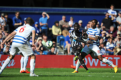 Newcastle United's Papiss Demba Cisse takes a shot - Photo mandatory by-line: Dougie Allward/JMP - Mobile: 07966 386802 - 16/05/2015 - SPORT - football - London - Loftus Road - QPR v Newcastle United - Barclays Premier League