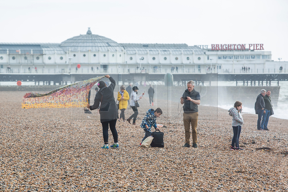 © Licensed to London News Pictures. 26/10/2019. Brighton, UK. Only a handful of people can be seen on the beach in Brighton and Hove as strong gusts of wind and powerful waves continue to hit the seaside resort. Photo credit: Hugo Michiels/LNP