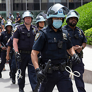 New York Police Department officers stand at the ready as protesters assemble at Foley Square in Lower Manhattan to rally and march due to the killing of George Floyd by a Minnesota Police Officer on Tuesday, June 2, 2020 in Lower Manhattan, New York.  A citywide 8 p.m. curfew was ordered by NY Mayor Bill de Blasio amid the Floyd protests. (Alex Menendez via AP)