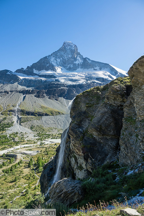 The Matterhorn (4478 m/14,692 ft) rises above Zmutt Valley. From Zermatt, hike the scenic Höhbalmen Höhenweg loop via Bergrestaurant Edelweiss, Trift Hut and Zmutt, in the Pennine Alps, Switzerland, Europe. With delightful views of alpine meadows, peaks and glaciers, this strenuous walk went up and down 1200 meters over 21.6 km (13.4 miles).