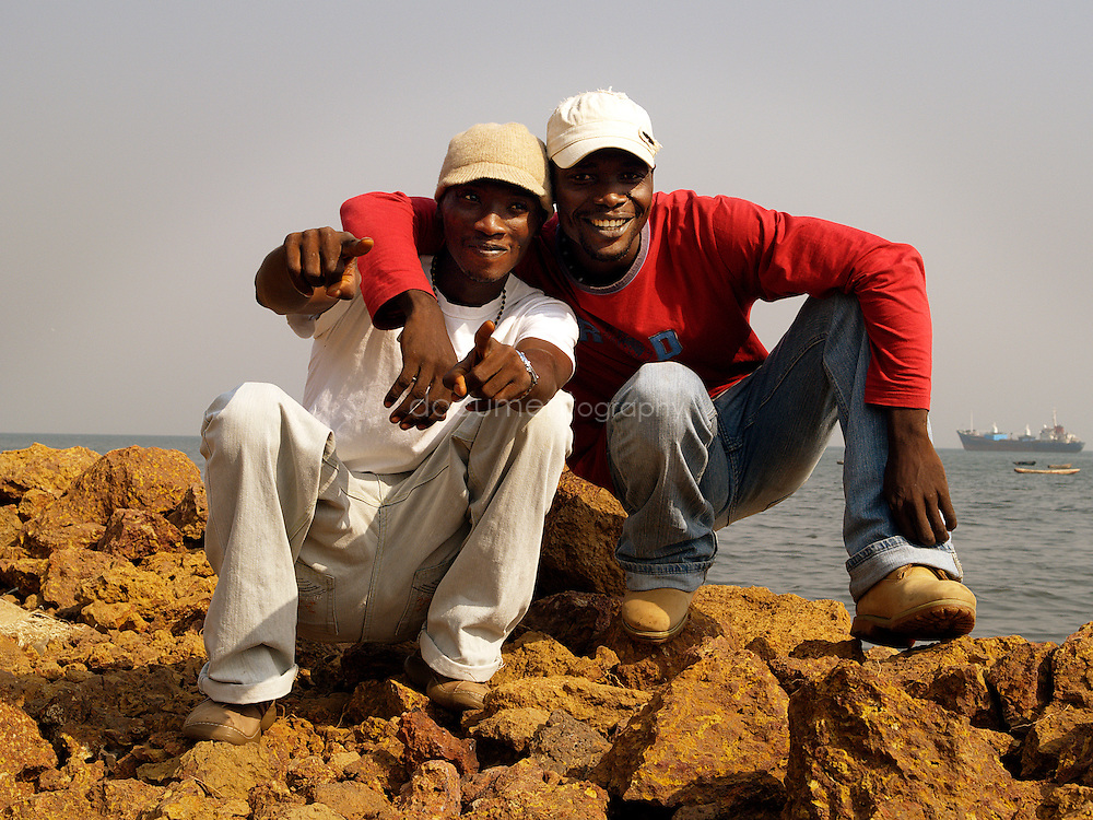 Ragga singers Double K, Koolking (right) and King Osu (left), Kroo Bay, Freetown, Sierra Leone.