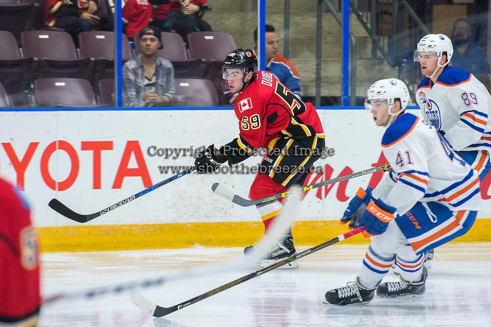 PENTICTON, CANADA - SEPTEMBER 17:  Dillon Dube #59 of Calgary Flames skates against Edmonton Oilers September 17, 2016 at the South Okanagan Event Centre in Penticton, British Columbia, Canada.  (Photo by Marissa Baecker/Shoot the Breeze)  *** Local Caption *** Dillon Dube;