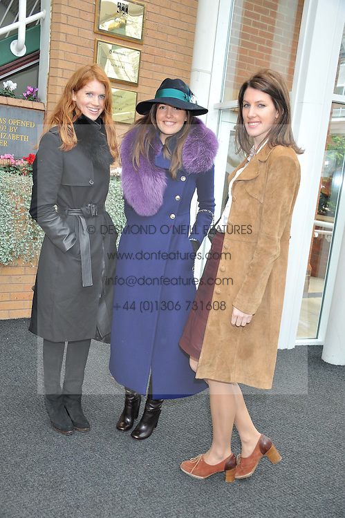 Left to right, LARA HUGHES YOUNG, AMANDA SHEPPARD and SUSANNA WARREN at the Hennessy Gold Cup at Newbury Racecourse, Berkshire on 26th November 2011.