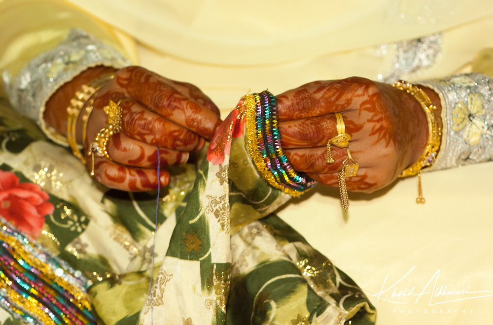 Decorating the hands with henna for women in Oman during special occasions