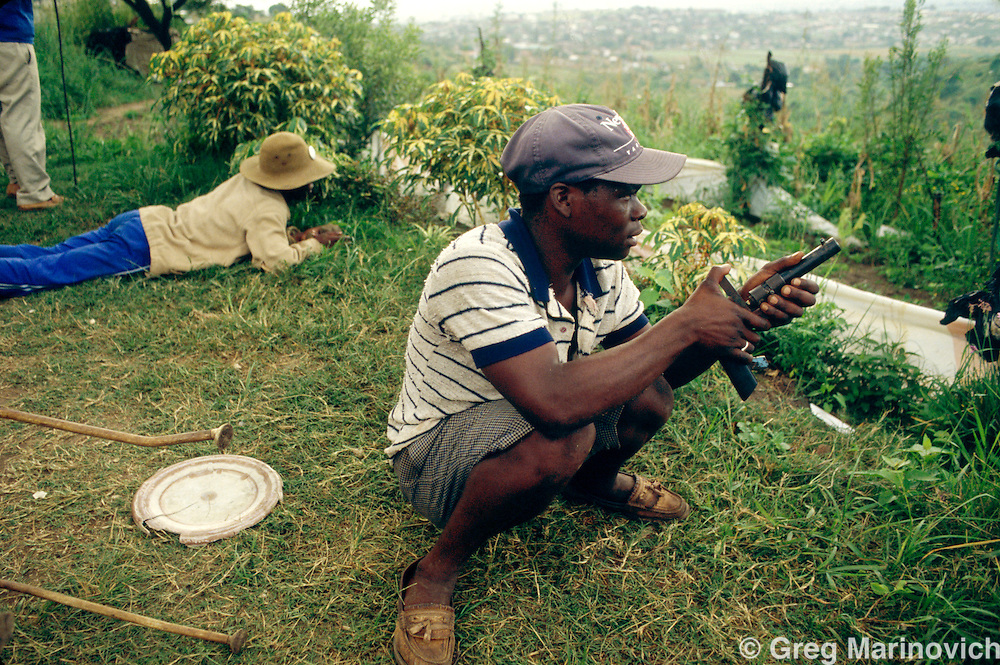 KwaMashu, KwaZulu Natal South Africa 1994. ANC militants with a home made gun or 'kwash' do battle with Inkatha Freedom party supporters across the valley. Richmond Farm Natal, South Africa