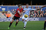 Eduardo Vargas of QPR and Daley Blind of Manchester United compete for the ball. Barclays Premier league match, Queens Park Rangers v Manchester Utd at Loftus Road in London on Saturday 17th Jan 2015. pic by John Patrick Fletcher, Andrew Orchard sports photography.