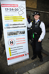 April 30, 2019 - London, United Kingdom - Police Officer seen during the Admiral Duncan Procession and Act of Remembrance on the 20th anniversary of the bombing at St Anne's Church gardens, Waterloo in London. (Credit Image: © Terry Scott/SOPA Images via ZUMA Wire)