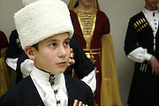 Circassian child in traditional dress, Israel. Magazine portrait by Debbie Zimelman, Modiin, Israel