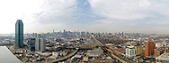 A view of Long Island City, NY with Manhattan in the background.  There are many famous landmarks in the photo from Silvercup Studios to the Citi Building.  Also, in the backround you can see the Empire State Building, Chrystler Building, Bank of America Building and much more.