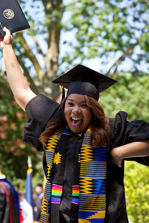 Tiffany Massey '12 responds in elation to recieving her diploma. BEN BREWER/Grinnell College