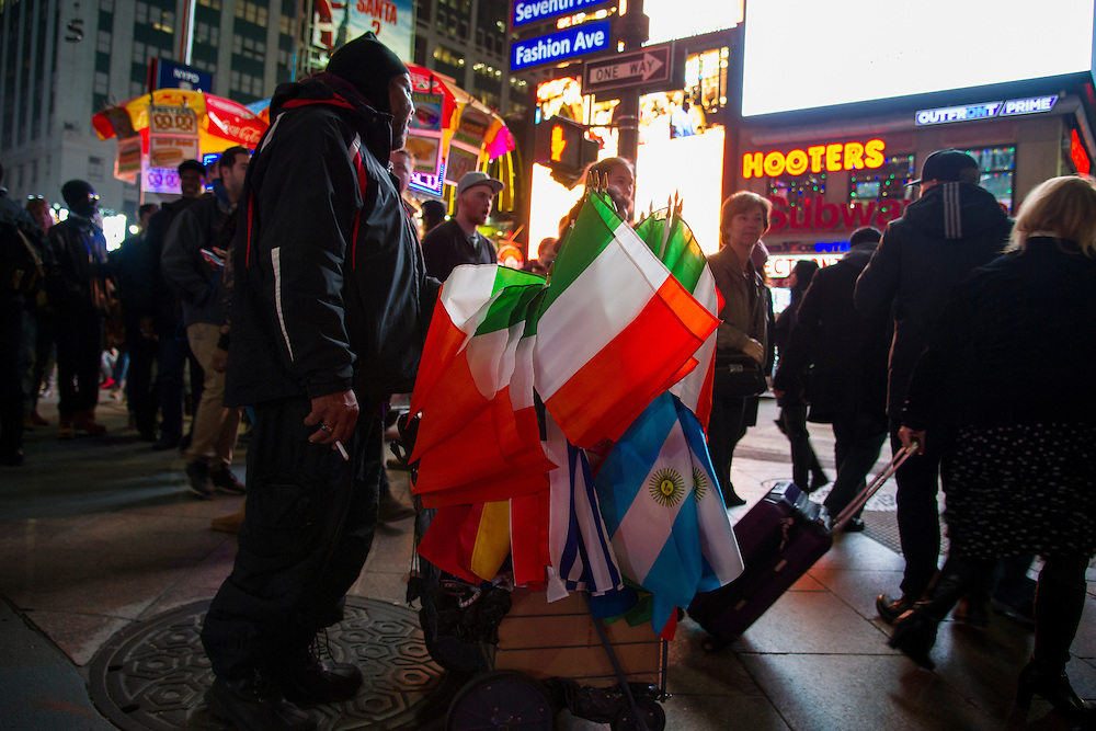 A vendor sells flags outside for UFC 205 at Madison Square Garden in New York, New York on November 12, 2016.  (Cooper Neill for The Players Tribune)