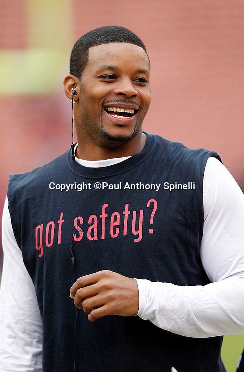 Arizona Cardinals safety Kerry Rhodes (25) smiles as he warms up before the NFL week 17 football game against the San Francisco 49ers on Sunday, January 2, 2011 in San Francisco, California. The 49ers won the game 38-7. (©Paul Anthony Spinelli)