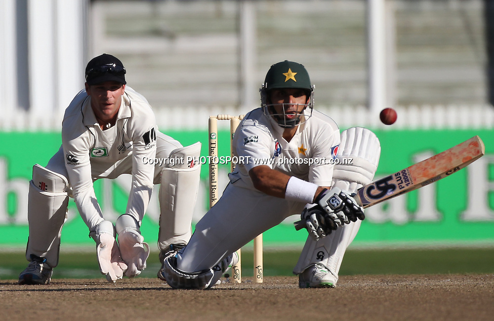 Pakistan's Misbah-ul-Haq batting as Reece Young looks on during Day 2 of the 1st test match.  New Zealand Black Caps v Pakistan, Test Match Cricket. Seddon Park, Hamilton, New Zealand. Saturday 8 January 2011. Photo: Andrew Cornaga/photosport.co.nz