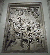 Relief depicting imperial triumph, with this panel showing the Emperor exercising mercy towards the barbarians as they kneel before him. Roman, circa 2nd century AD.