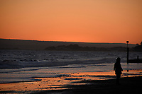 Person on the beach at sunset