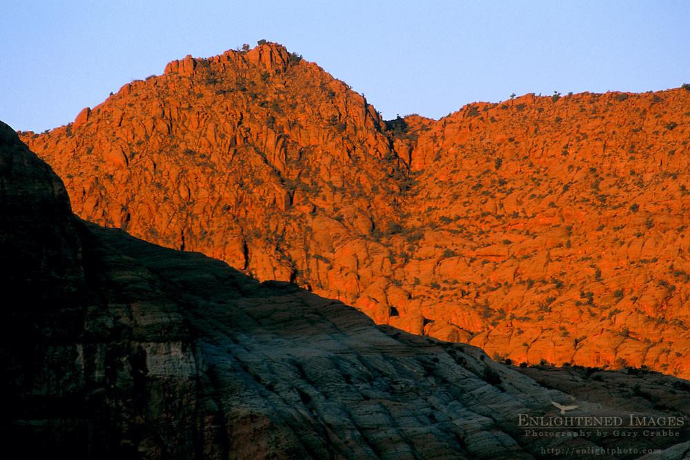 Sunrise light on red sandstone peak in Snow Canyon State Park, Ivins, Utah's Dixie, near St. George, UTAH
